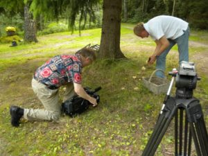 DP Ilmo Lintonen shooting Paavo Turtiainen picking mushrooms in Finland